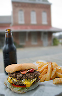 A bacon double cheeseburger, french fries, and a bottle of IBC rootbeer sits on a picnic table outside Phillip's Grocery Sept. 24, 2011 in Holly Springs, Miss. The saloon-turned-burger joint has become a mecca for tourists and travel writers. In 1989, USA Today named the burger among the top three in the nation. (Photo by Carmen K. Sisson/Cloudybright)