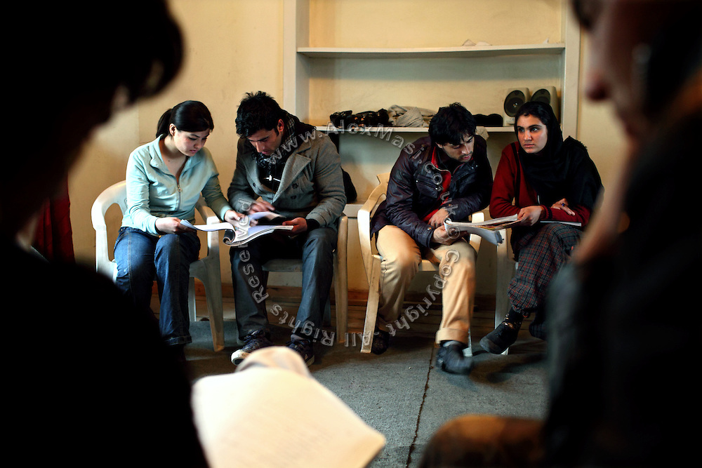 Mixed members of the Aftab Theatre Group, one of the few performing teams in Kabul, are revising their acts while taking part to a practising session in Kabul, Afghanistan.
