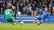 Luke Norris slides in for a 50/50 ball with Thorsten Stuckmann during the Sky Bet League 1 match between Gillingham and Doncaster Rovers at the MEMS Priestfield Stadium, Gillingham, England on 5 September 2015. Photo by Andy Walter.
