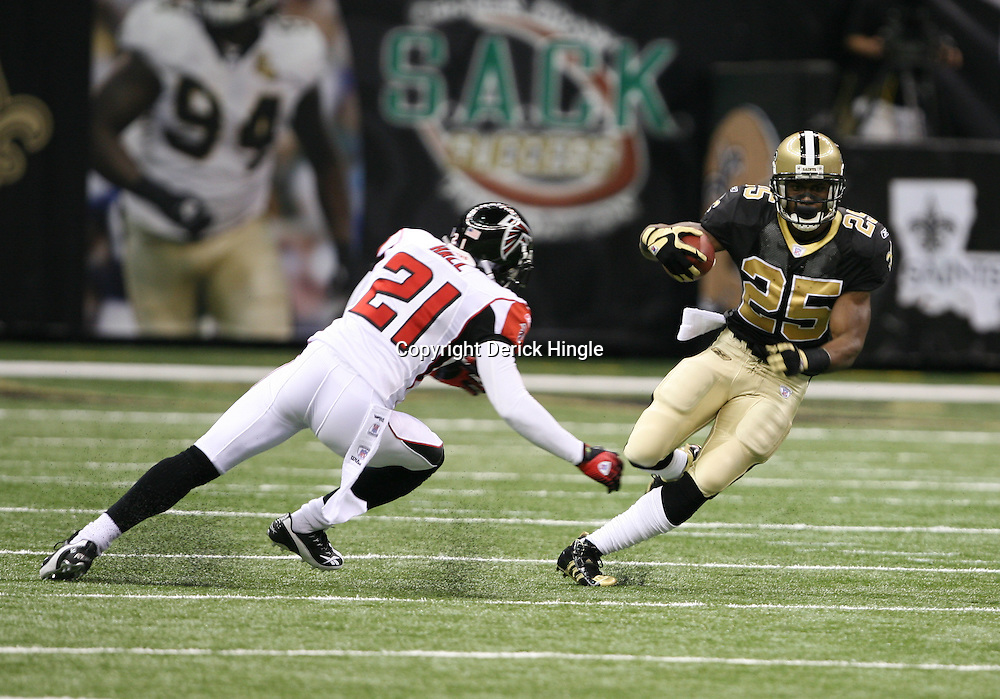 2007 October, 21: New Orleans Saints running back Reggie Bush (25) runs past Falcons defensive back DeAngelo Hall(21) during a 22-16 win by the New Orleans Saints over the Atlanta Falcons at the Louisiana Superdome in New Orleans, LA.