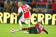 Ajax midefielder Noa Lang (37) and Flamengo forward Miguel Trauco (13) go for a ball during a Florida Cup match at Orlando City Stadium on Jan. 10, 2019 in Orlando, Florida. <br /> Flamengo won in penalties 4-3.<br /> <br /> ©2019 Scott A. Miller
