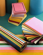 coloured paper cut to different shapes and sizes for different office work such as printers, notes and memos