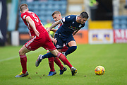 10th August 2019; Dens Park, Dundee, Scotland; SPFL Championship football, Dundee FC versus Ayr; Declan McDaid of Dundee wriggles past Sam Roscoe of Ayr United
