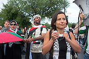 Hala Yassin, an organizer of the event speaks to denounce the attitude of the Canadian government and companies that continue to do business with Israel and is complicit harm caused to the Palestinians.