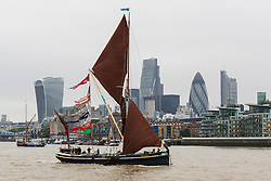 © Licensed to London News Pictures. 17/09/2016. LONDON, UK.  Sailing barges (Edith May seen in front) parade on the River Thames, passing under Tower Bridge in London for the first ever Thames Sailing Barge Parade. The event aims to recreate scenes from Londonís days as a bustling trading port and the historic sailing barges taking part have not been seen together in one place since the industrial revolution.  Photo credit: Vickie Flores/LNP