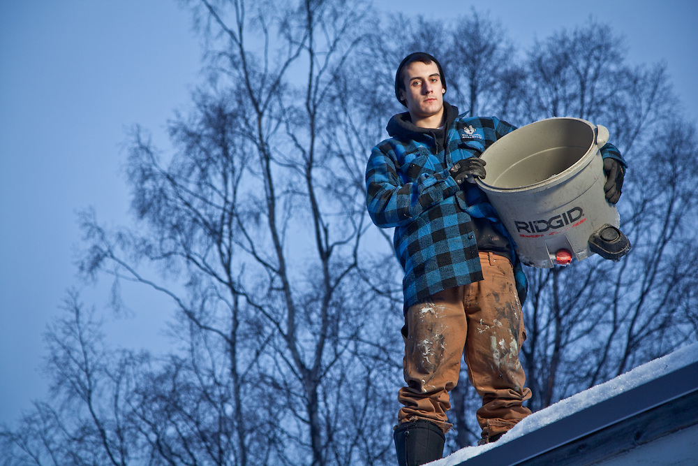 Weatherization Specialist, Chris Robinson, on the roof of a home in Anchorage's South Addition.
