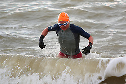 © Licensed to London News Pictures. 17/01/2015. Brighton, UK. Members of the Brighton and Hove Sea Swimming Club taking part in their daily exercise. A very cold day and the occasional shower in Brighton and the South Coast with temperatures expected to reach a maximum of 4C down the South Coast. Photo credit : Hugo Michiels/LNP