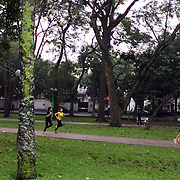 Joggers near the Lenin statue in Duong Dien Bien Phu Street, Hanoi, Vietnam.. For a county not know for it's sporting prowess, Hanoi, Vietnam's capital, appears to be gripped in a fitness frenzy. Before 6am street corners, parks and lake sides are a hive of activity as keep fit classes, Tai chi and personal exercise regimes are seen in abundance around the city. Particularly noticeable are Women's keep fit classes, often accompanied by loud poor quality western disco beat music as the occupants of the city get fit come rain or shine. Hanoi, Vietnam. 18th March 2012. Photo Tim Clayton