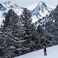 Skiers run down the ski slopen of Bansko ski area