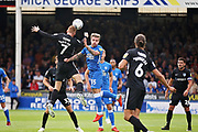 Portsmouth midfielder Tom Naylor (7) clears ahead of Peterborough United forward Jason Cummings (35) during the EFL Sky Bet League 1 match between Peterborough United and Portsmouth at London Road, Peterborough, England on 15 September 2018.