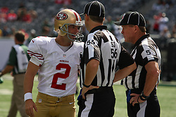 Sept 30, 2012; East Rutherford, NJ, USA; San Francisco 49ers kicker David Akers (2) welcomes back side judge Allen Baynes (56) and head linesman John McGrath (5) before the game between the New York Jets and the San Francisco 49ers at MetLIfe Stadium.