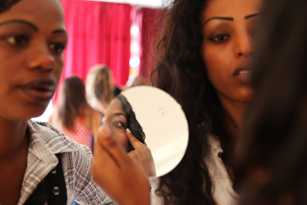 Ethiopian women check their makeup in preparation for the first ever Miss Ethiopia beauty pageant in Lebanon organized by the Ethiopian community.