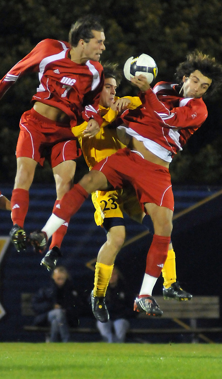 Matt Stummer (yellow) fights for the ball as he goes up for a header in a game against Illinois-Chicago, Thursday Oct. 2 2008. The Marquette Warriors Lost 1-0.