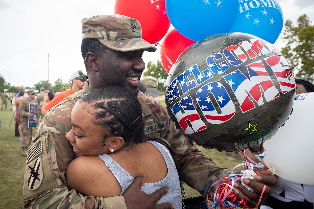 FORT STEWART, GA - JULY 17, 2019: Corporal Jabarri Hester of Atlanta gets a hug from Shariyah Calhoun of  Cedartown, Ga,, during a homecoming ceremony for the soldiers of the Macon-based 48th Infantry Brigade Combat Team Wednesday, July 17 2019 at Ft. Stewart, Ga. The unit finished a seven month deployment to Afghanistan in support of Operation Resolute Support. (AJC Photo/Stephen B. Morton)