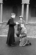 14/03/1964<br /> 03/14/1964<br /> 14 March 1964<br /> Ordination of Fr. Donal Sullivan at Holy Cross College (Clonliffe College), Clonliffe Road, Drumcondra, Dublin. Picture shows Fr. Donal Sullivan, C.M., Kenilworth, Ballinacurra, Co. Limerick, giving his blessing to his father Mr P. Sullivan, while his mother looks on.