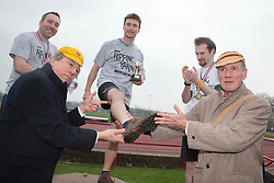 "© Licensed to London News Pictures. 03/03/2012. London, England. L-R Terry Jones, Ben Lansley, winner of the 400m race and Michael Palin. Terry Jones and Michael Palin of Monty Pythons fame today, Saturday 3 March, staged a public ""Hopathon"" to mark the DVD release of Ripping Yarns The Complete Series, and as an homage to the episode entitled Tomkinsons School Days at the Athletics Track in  Hampstead Heath, London. Photo credit: Bettina Strenske/LNP"