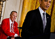 Stan Musial listens as President Barack Obama speaks in the East Room of the White House during a ceremony which saw Musial receive the Medal of Freedom Medal from the president  in Washington DC on February 15, 201. Photo by Kris Connor