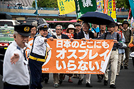 People hold a banner during the May Day rally in Tokyo on Monday, May 1, 2017, Thousands people participate demanding higher pays among other issues. 01/05/2017-Tokyo, JAPAN
