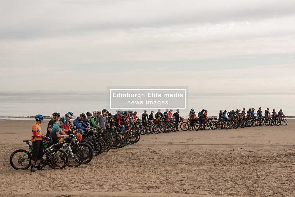 Fifty intrepid mountain bikers set off from Portobello beach this morning on a weekend time-trial tour of the Lothians and Borders. The event - not a race, but more of a personal challenge - will take them just shy of 150 miles over the next two days.<br /> <br /> <br /> © Jon Davey/ EEm