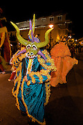 A costumed reveler called a vejigante dances in the streets during the Carnaval de Ponce February 20, 2009 in Ponce, Puerto Rico. Vejigantes are a folkloric character representing the devil.