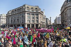 © Licensed to London News Pictures. 15/04/2019. London, UK. Environmental activists from the Extinction Rebellion movement block Oxford Circus with a boat as part of a series of direct actions taking place across the capital. The protests demand urgent action from governments on climate change. Photo credit: Rob Pinney/LNP