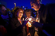 """15 JANUARY 2011 - TUCSON, AZ: People attend a Jewish religious service at a memorial on the lawn in front of the University Medical Center in Tucson, AZ, Saturday, January 15. The memorial has been growing since the mass shooting last week. Six people were killed and 14 injured in the shooting spree at a """"Congress on Your Corner"""" event hosted by Congresswoman Gabrielle Giffords at a Safeway grocery store in north Tucson on January 8. Congresswoman Giffords, the intended target of the attack, was shot in the head and seriously injured in the attack. She is hospitalized at UMC. The alleged gunman, Jared Lee Loughner, was wrestled to the ground by bystanders when he stopped shooting to reload the Glock 19 semi-automatic pistol. Loughner is currently in federal custody at a medium security prison near Phoenix.  Photo by Jack Kurtz"""