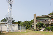 Aoshima, Ehime prefecture, September 4 2015 - The abandonned school of Aoshima island. Mobile phone operator Docomo recently installed a relay mast on the former school playground.<br /> Aoshima (Ao island) is one of the several « cat islands » in Japan. Due to the decreasing of its poluation, the island now host about 6 times more cats than residents.
