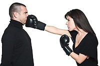 studio shot portrait on isolated white background of a Beautiful Funny couple expressive fighting