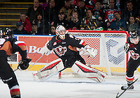 KELOWNA, CANADA - FEBRUARY 28:Brendan Burke #1 of Calgary Hitmen defends the net against the Kelowna Rockets  on February 28, 2015 at Prospera Place in Kelowna, British Columbia, Canada.  (Photo by Marissa Baecker/Shoot the Breeze)  *** Local Caption *** Brendan Burke;