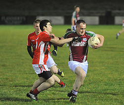 Shrule-Glencorrib's Joe Geraghty bursts past the Garrymore players during the South Mayo Junior B final.<br /> Pic Conor McKeown