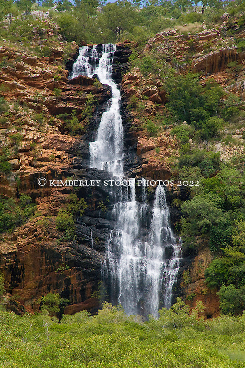 Water cascades down a waterfall in Dugong Bay on the Kimberley coast at the end of the wet season.