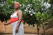 Josephine Akissi Coulibaly, 52, a former FGM/C practitioner, poses for a picture in her traditional ceremonial attire at her home in the town of Katiola, Cote d'Ivoire on Friday July 12, 2013. Josephine abandoned the practice thanks to advocacy work by UNICEF partner organization OIS Afrique.