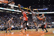 Feb 4, 2016; Phoenix, AZ, USA;  Houston Rockets guard Corey Brewer (33) drives the ball against the Phoenix Suns defense at Talking Stick Resort Arena. Mandatory Credit: Jennifer Stewart-USA TODAY Sports