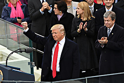 January 20, 2017 - Washington, DC, U.S. - President  DONALD J. TRUMP holds his fist in victory following his Inaugural address after being sworn-in as the 45th President on Capitol Hill. (Credit Image: © Richard Ellis via ZUMA Wire)
