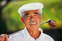 Smiling Golfer Holding Golf Club --- Image by © Jim Cummins/CORBIS
