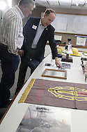 Retired Fairborn Police Chief Ron Carbaugh (right) shows Herman Jeffers, from Bath Township one of the photos on display at a reunion of Fairborn fire fighters at the Fire Administration offices, Friday, April 11, 2008.