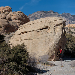 Mark Howell bouldering on Propane Boulder at the Sandstone Quarry in Red Rock Canyon, Las Vegas, Nevada