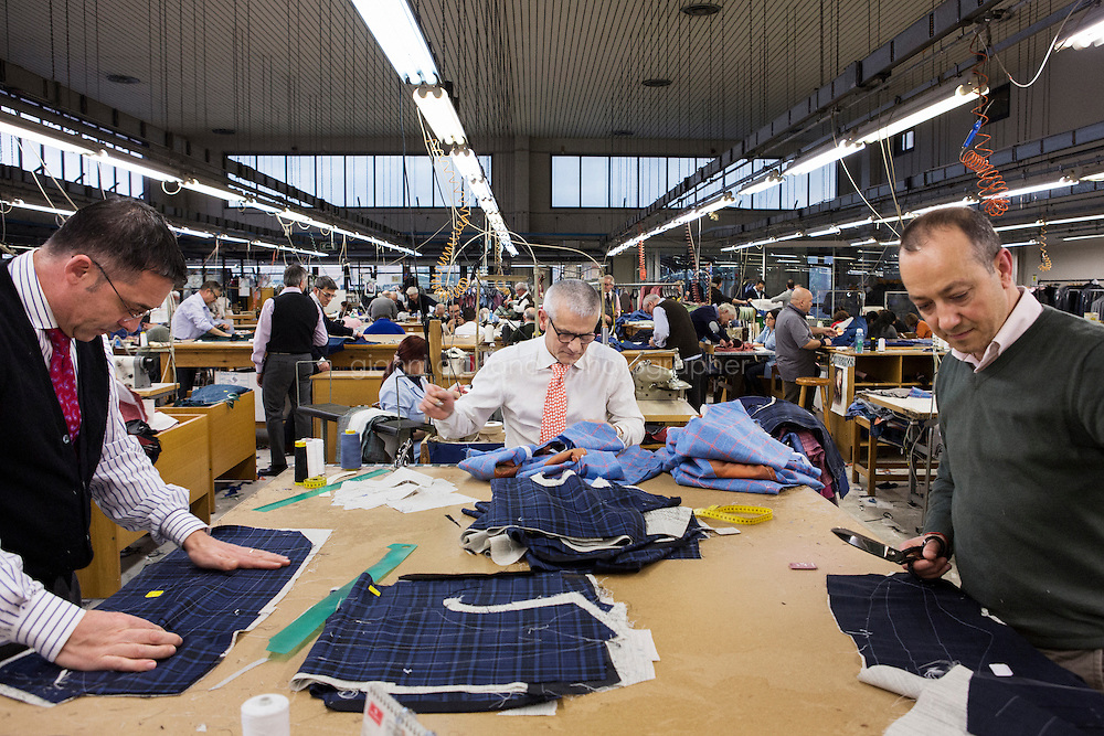 ARZANO, ITALY - 16 January 2014: Tailors work on blazers at the Kiton factory in Arzano, Italy, on January 16th 2014.