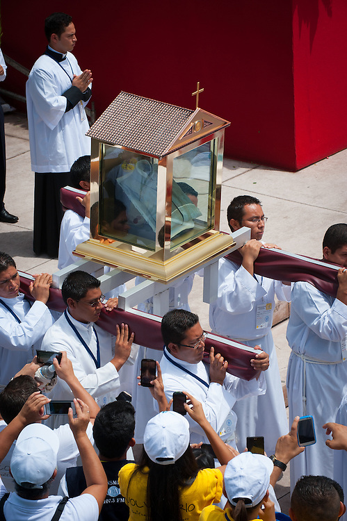 Salvadoran Catholic priests carry a relic - The blood stained shirt - of martyred Archbishop Oscar Romero.  The Archbishop was slain at the alter of his Church of the Divine Providence by a right wing gunman in 1980. Oscar Arnulfo Romero y Galdamez became the fourth Archbishop of San Salvador, succeeding Luis Chavez, and spoke out against poverty, social injustice, assassinations and torture. Romero was assassinated while offering Mass on March 24, 1980.