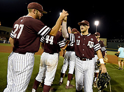 Texas A&M's J.B. Moss (11) celebrates a 7-1 win over TCU with teammate Ryan Hendrix (27) after a NCAA college baseball Super Regional tournament game, Saturday, June 11, 2016, in College Station, Texas. (AP Photo/Sam Craft)