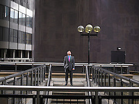 Man standing at top of steps looking up