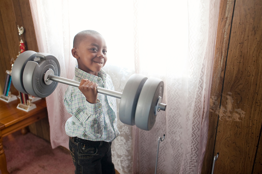 Justin Cobb shows off his weight lifting skils inside his home near La Grange, N.C., on Sunday, Feb. 14, 2010. Justin recently had a bad earache and recovered without the aid of antibiotics, as advised by a doctor. ..D.L. Anderson for The Wall Street Journal.EAR