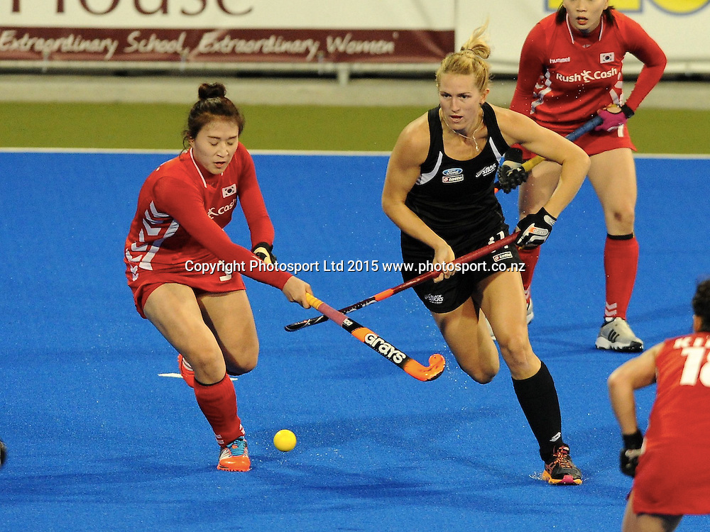 New Zealand Black Stick Stacey Michelsen gets past Koreas Sohui Yu in the Festival of Hockey, New Zealand Womens Black Sticks v Korea, Unison Sports Park, Hastings, Saturday, April 118 2015. Photo: Kerry Marshall / photosport.co.nz
