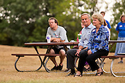 Congressman Todd Akin sits with his wife, Lulli, while waiting to address the groud during a rally at Springfield Lake Park on July 30, 2012 in Springfield, Missouri. (David Welker/TurfImages.com).