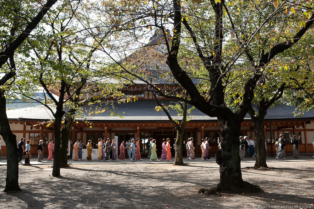 People moving out of a meetig during festivities for a coming of age ceremony in Yasukuni shrine, Tokyo.