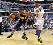 Feb. 21, 2012; Indianapolis, IN, USA; New Orleans Hornets small forward Trevor Ariza (1) dribbles the ball to the corner as Indiana Pacers small forward Danny Granger (33) guards at Bankers Life Fieldhouse. Indiana defeated New Orleans 117-108. Mandatory credit: Michael Hickey-US PRESSWIRE