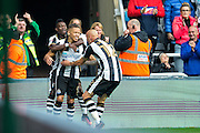 Newcastle United forward Dwight Gayle (#9) and Newcastle United midfielder Jonjo Shelvey (#12) celebrate the second Newcastle United goal scored by Newcastle United forward Dwight Gayle (#9) during the EFL Sky Bet Championship match between Newcastle United and Brentford at St. James's Park, Newcastle, England on 15 October 2016. Photo by Craig Doyle.
