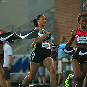 GARDNER - 13USA, Des Moines, Ia.  - English Gardner won the 100 (left) with Octavious Freeman finishing second and Alexandria Anderson finishing third.  Photo by David Peterson