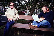 Swayzak working on their laptops in a park London August 2002