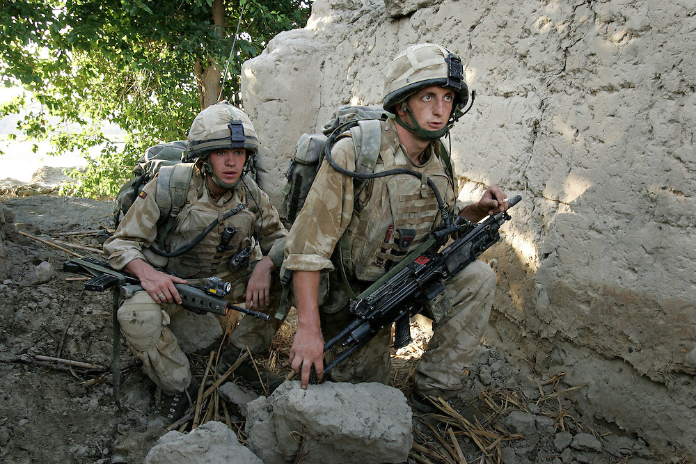 29/06/07..Sangin Valley, Helmand, Afghanistan..Soldiers from A Company 1 Battalion Royal Anglians, known as 'The Vikings' take cover in the ruins of a compound after an RPG (Rocket Propelled Grenade) attack whilst conducting operations against the Taliban in the Sangin Valley, Helmand province, Afghanistan on the 29th June 2007...The soldiers made a Tactical Advance to Battle over night carrying just food, water and ammunition. At first light they moved on their objectives; a series of compounds, orchards and paddy fields. During the day they exchanged fire with the enemy on a number of occasions. 13 Taliban were killed, 1 British soldier and 3 Afghan troops were wounded.